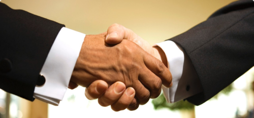 080813-national-us-corporations-shake-hands-with-africa-businessmen-shaking-hands.jpg