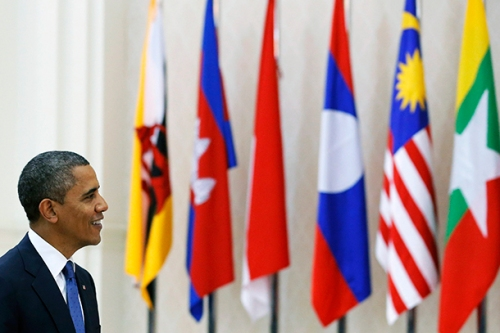 U.S. President Barack Obama passes in front of ASEAN members flags as he arrives for the Plenary session of the 21st ASEAN (Association of Southeast Asian Nations) and East Asia summits in Phnom Penh November 20, 2012. REUTERS/Damir Sagolj (CAMBODIA - Tags: POLITICS) - RTR3AN13